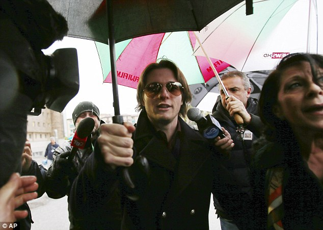 In court: Raffaele Sollecito arrives at court in Florence, Italy, for the final hearing ahead of the verdict in the latest Meredith Kercher murder trial