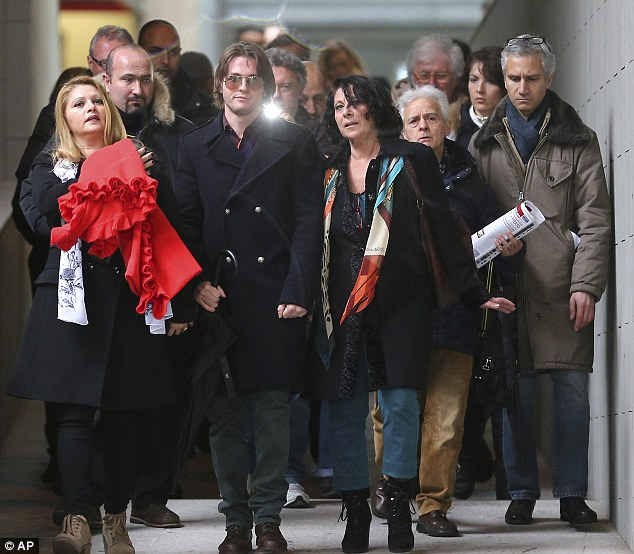 Support: Raffaele Sollecito is flanked by his stepmother Mara Papagni, left, and his aunt Sara Achille, right, as he leaves court after attending the final hearing before the third verdict for the murder of British student Meredith Kercher