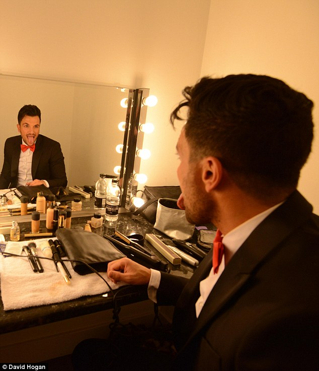 Playing around: Peter Andre jokes around in the dressing room ahead of his photoshoot