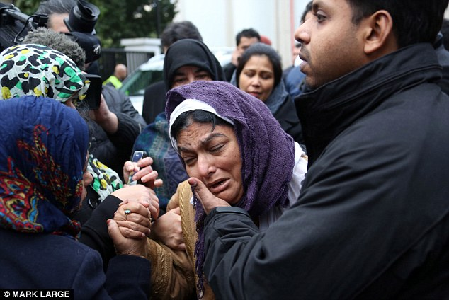 Heartbreak: Mrs Fatima Khan at the funeral of her son at Regents Park Mosque in London