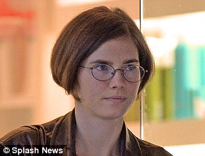 New look: Amanda Knox unveiled a dramatic new haircut in Seattle yesterday ahead of judges delivering their verdict on the Meredith Kercher murder trial today