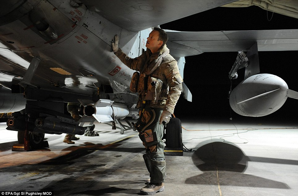 Saying farewell: Squadron Leader Mark Jackson carries out pre-flight checks before his final flight aboard the aircraft in Afghanistan. They will soon return to Scotland