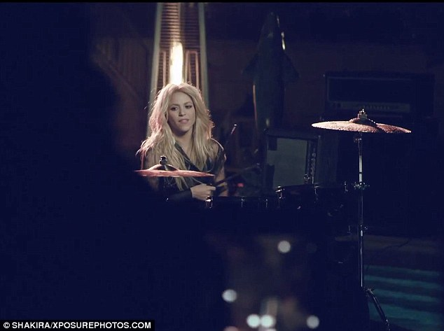 Drum roll: The 55-minute teaser also shows Shakira playing the drums