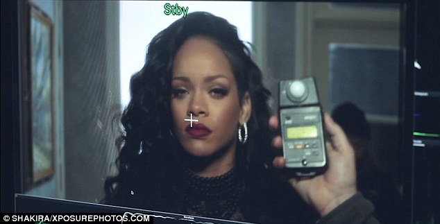 Ready for her close-up: Rihanna smoulders with a heavy-lidded look as crew prepare the scene
