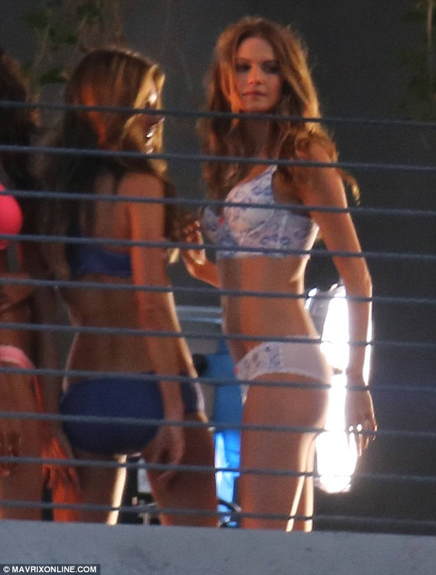 Stripping down: Behati shrugged off her robe for the group shot with the other angels