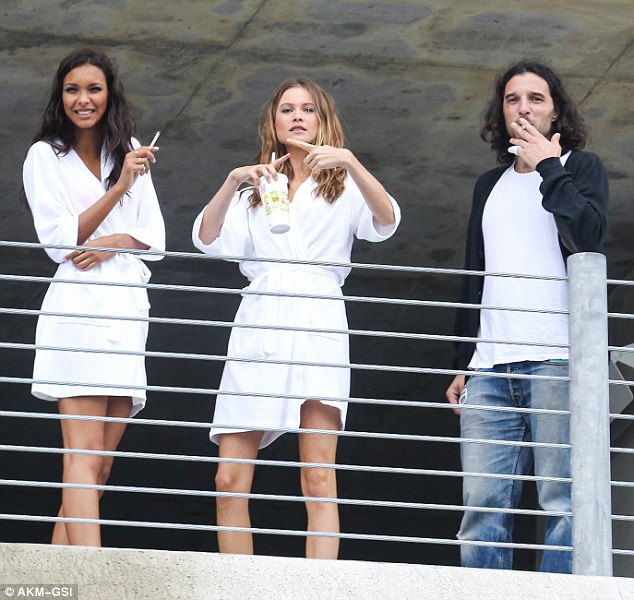 Hilarious: Lais and Behati interacted with the photographers during their break