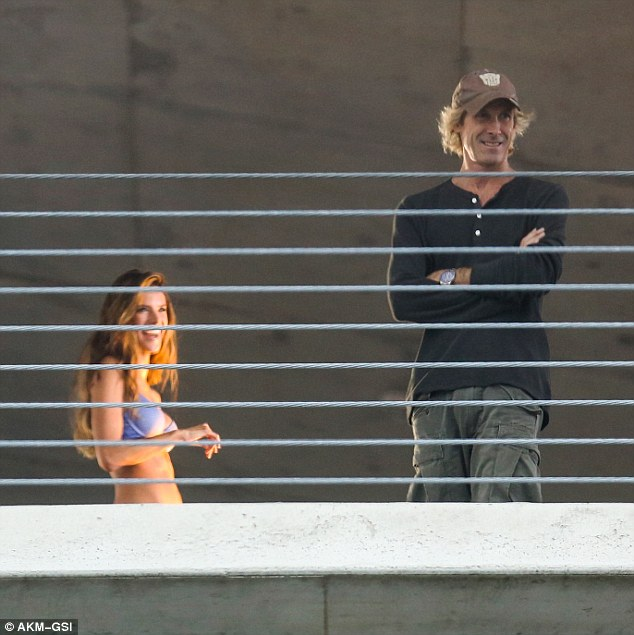 In his element: Michael Bay laughed on set as Alessandra giggled behind him