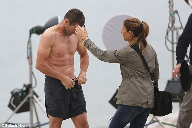 Star power: The Thank You For Smoking actor also adjusted his shorts while a stylist touched up his hair