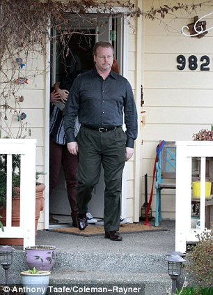 Distressed: Amanda Knox's mother, Edda Mellas in blue sweater & red coat exit their family home in Seattle as her father curt Knox in black shirt and trousers get into a black town car for their journey to be interviewed by ABC News