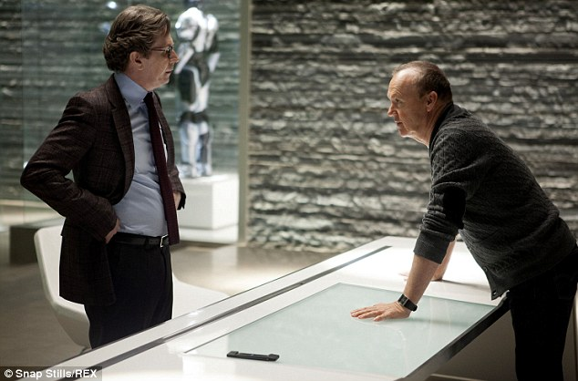Corporate evil: Gary Oldman, left, portrays the OmniCorp scientist who creates RoboCop and Michael plays the CEO of OmniCorp