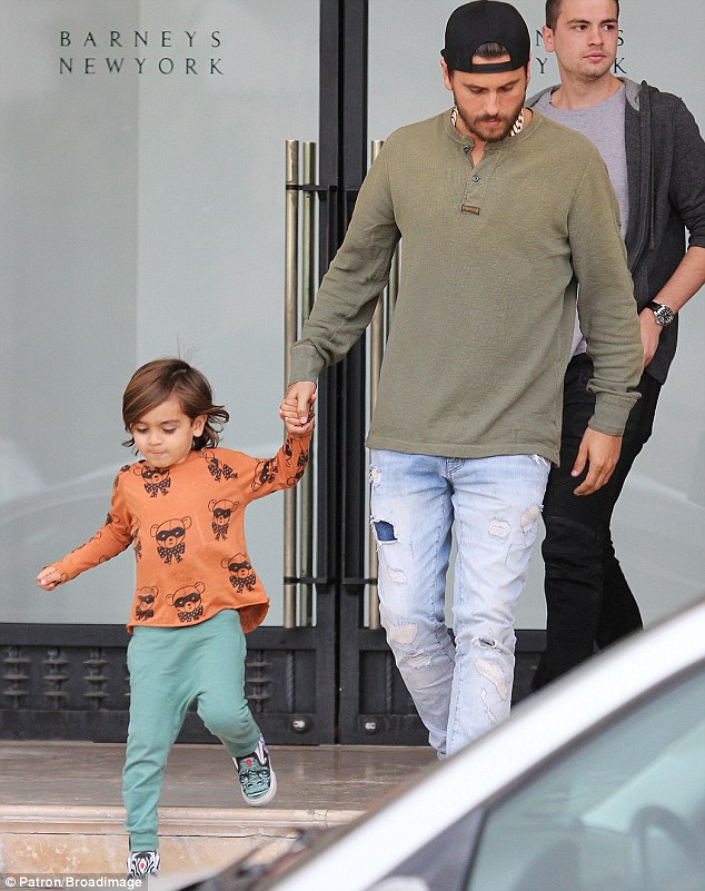 Daddy's boy: The hunky 30-year-old and his little lad hit high-end fashion store Barneys New York