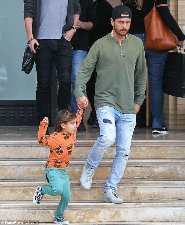 No letting go: The four-year-old tried to run down the stairs faster than his dad but the businessman and model held on fast to the boy's hand