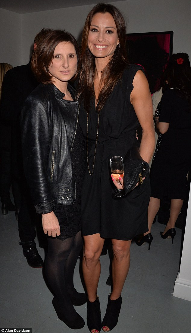 Time for some bubbles: The brunette, pictured with the creator of the Studio 10 range Grace Fodor, showed off her slim pins in the plunging number, which featured a draped design and cinched in waist