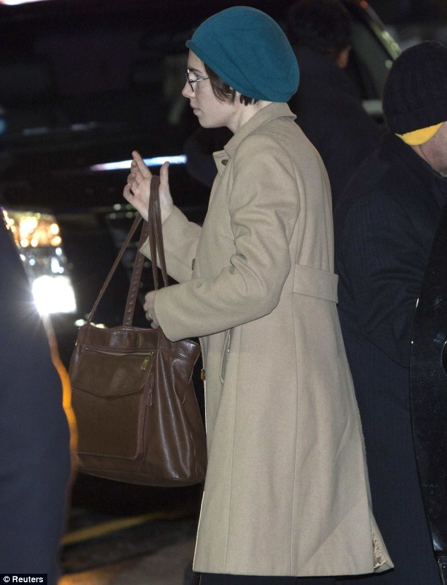 Amanda Knox was pictured in a camel trench coat and turquoise hat as she arrived at the set of ABC's 'Good Morning America' to be interviewed