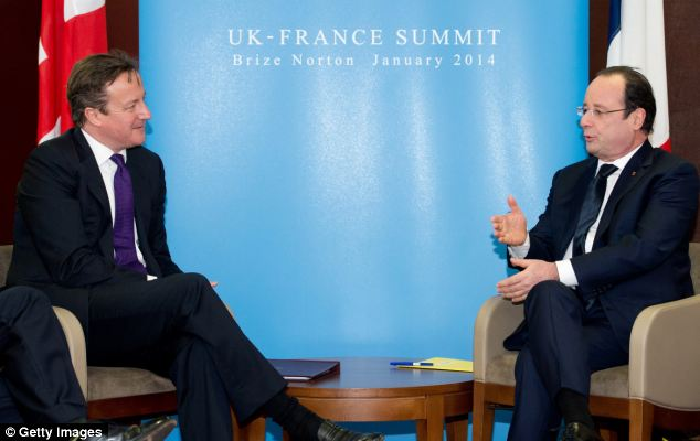 Tense: British Prime Minister David Cameron hosted Mr Hollande for the one-day summit at RAF Brize Norton but the two men clashed about reforming Europe
