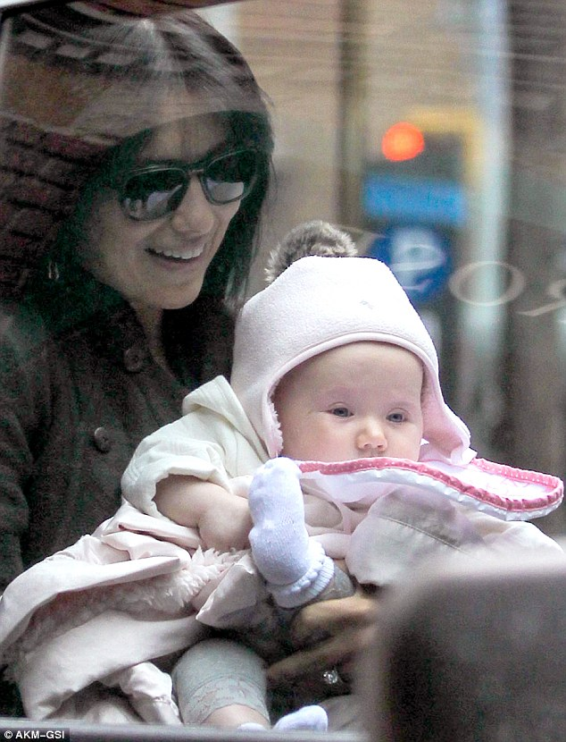 Drop-off: The 29-year-old Yogi appeared to carry her daughter into a much warmer car