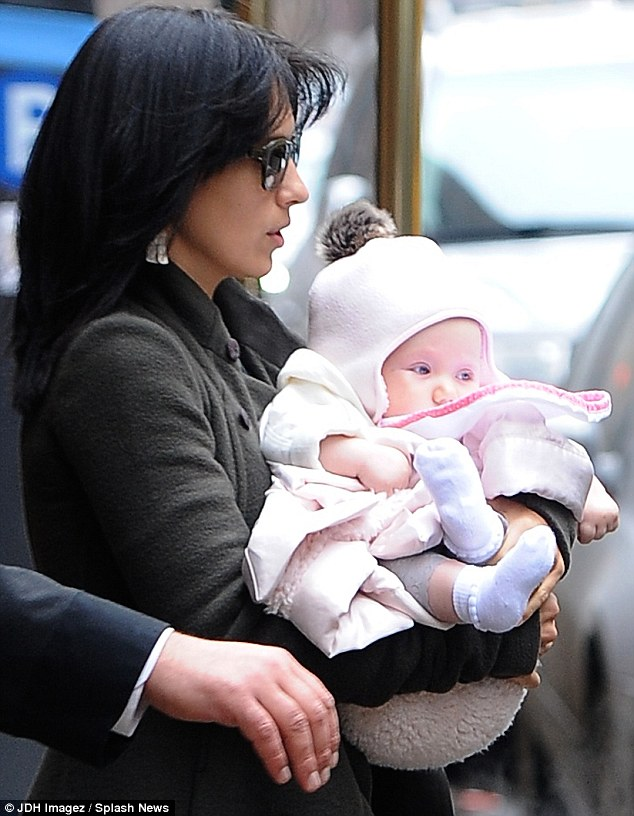 Motherly love: The 29-year-old cradled her daughter on the cold streets of the Big Apple
