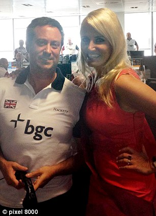 Model employee: Mr Clark poses in the office with model Nancy Sorrell