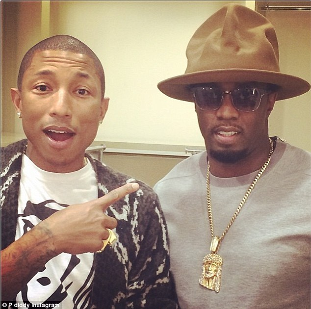 He took it! Pharrell Williams posed comically with P Diddy for an Instagram snap featuring his prized hat shortly after the Grammys