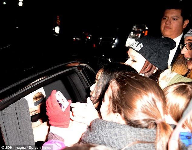 Crush: Fans mob the 19-year-old's car as he arrives at a New York hotel