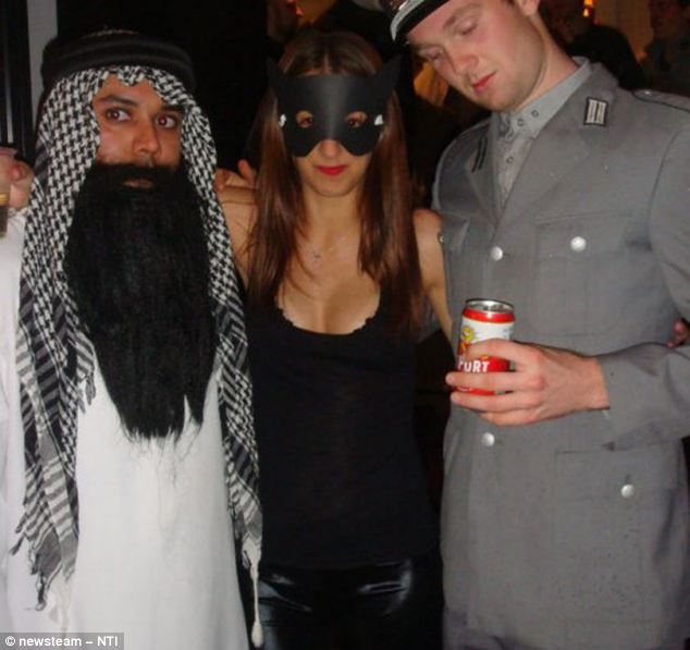 Fancy dress: Jodie Jones poses with a man in German uniform and another in Middle Eastern garb in 2009
