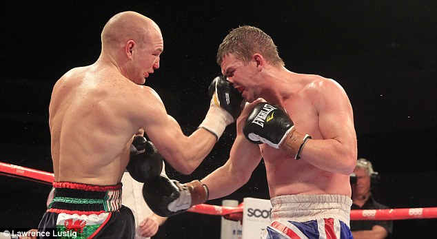 Toe-to-toe war: Gary Buckland (right) took a split decision victory over Gavin Rees at lightweight