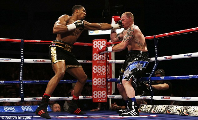 Power puncher: Heavyweight Anthony Joshua (left) frequently landed with troublesome shots