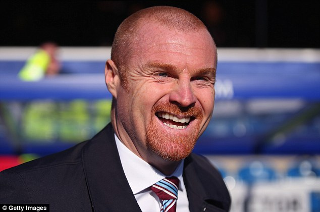 Plenty to smile about: Sean Dyche and Burnley are still in the promotion hunt after the draw with QPR