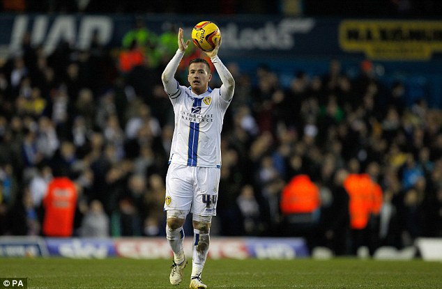 Hat-trick hero: Ross McCormack celebrates with the matchball after Leeds beat Huddersfield