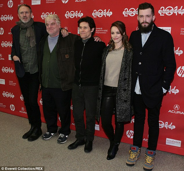 In demand: The 46-year-old posing with Wanted co-stars Rachel McAdams and Willem Dafoe, among others