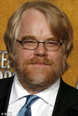 Not an easy time: Hoffman, left in January, and right in 2006 while winning a Screen Actor's Guild Award