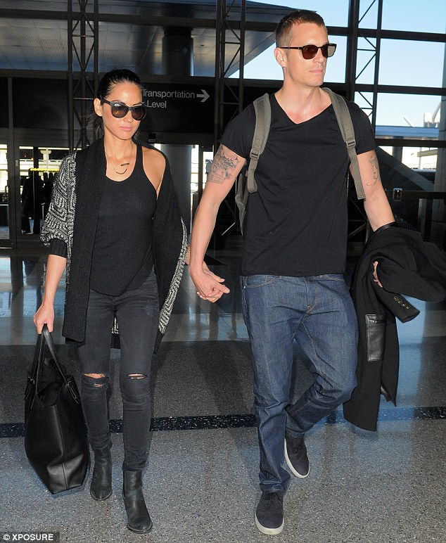 Time for croissants! Olivia and Joel looked a lot more casual when they headed into LAX on Saturday to catch their flight to France