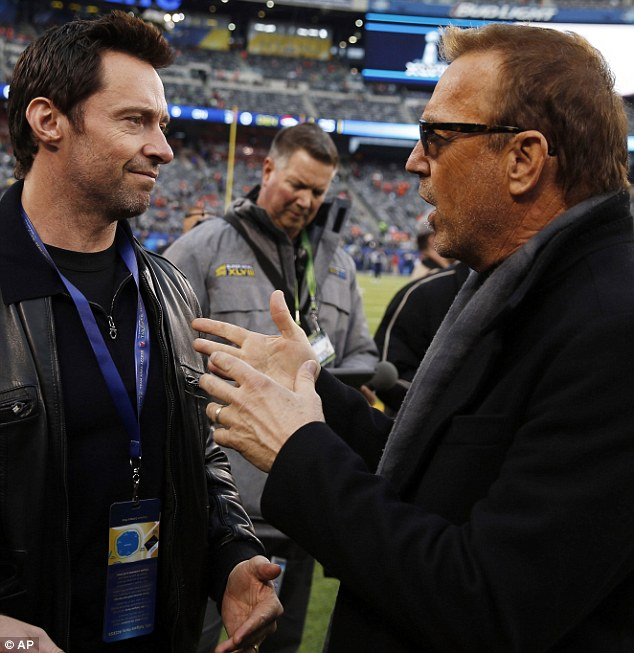 Pre-game excitement: Prior to the big game Hugh was pictured talking to actor Kevin Costner