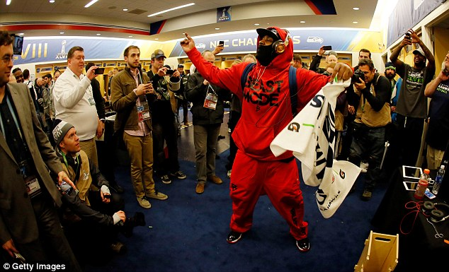 Party time: Lynch celebrates in the locker room after Seattle's Super Bowl victory over the Denver Broncos