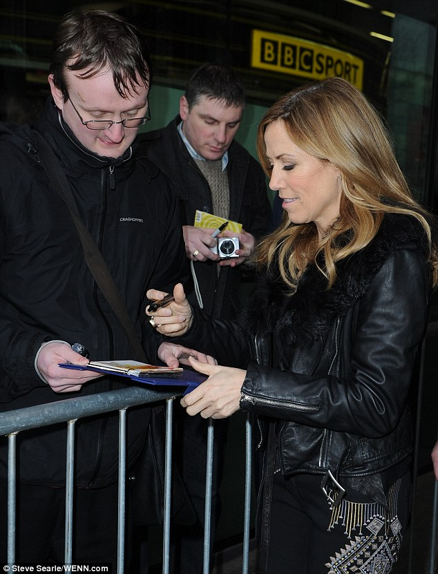 But of course! The crooner was happy to sign autographs for doting fans outside the studio