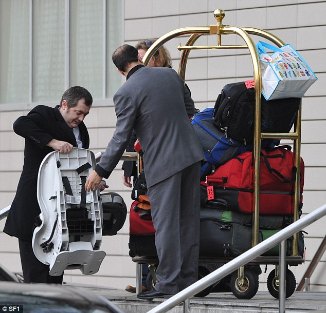 That's a lot of luggage! The singer was seen leaving with tons of bags and her guitar case