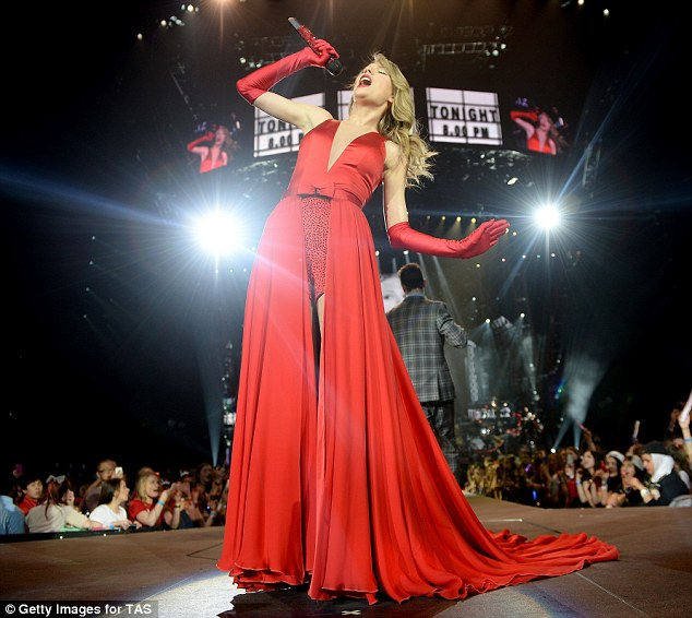 Scarlet woman: The country pop star positively dazzled in her flowing red satin ensemble