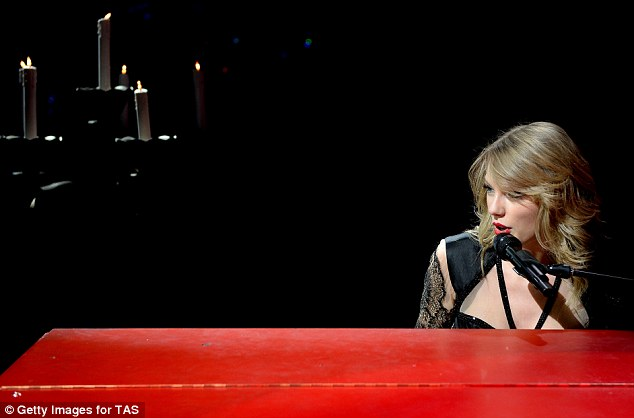 Stripping it back: Taylor took things back to basics as she belted out a track while tinkling away on her piano