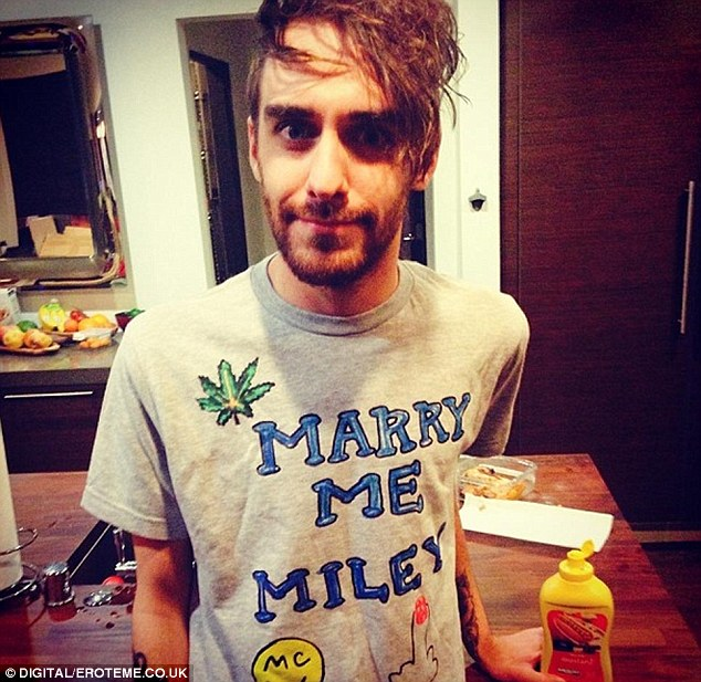 Marry me? Another shot posted on her Instagram page showed Miley's assistant Cheyne Thomas wearing a simple grey T-shirt with, 'Marry me Miley' in its centre