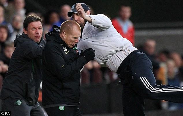 Aggression: Lennon (centre) was the victim of a touchline attack in 2011