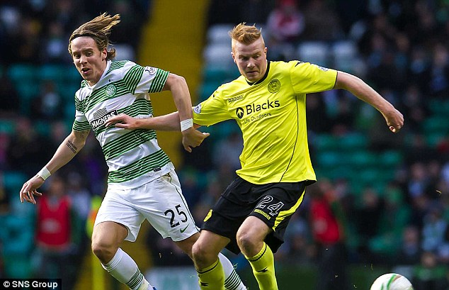 Battle: Celtic's Stefan Johansen (left) is held off by Conor Newton during Celtic's 1-0 win against St Mirren