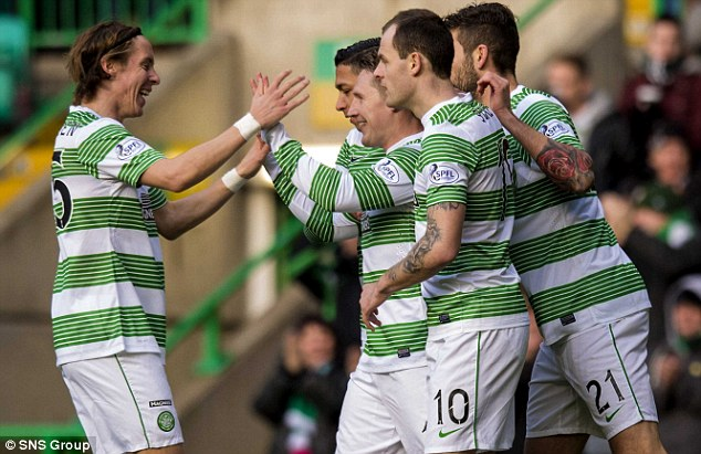Unbeaten: Commons (third left) is congratulated by his Celtic team-mates