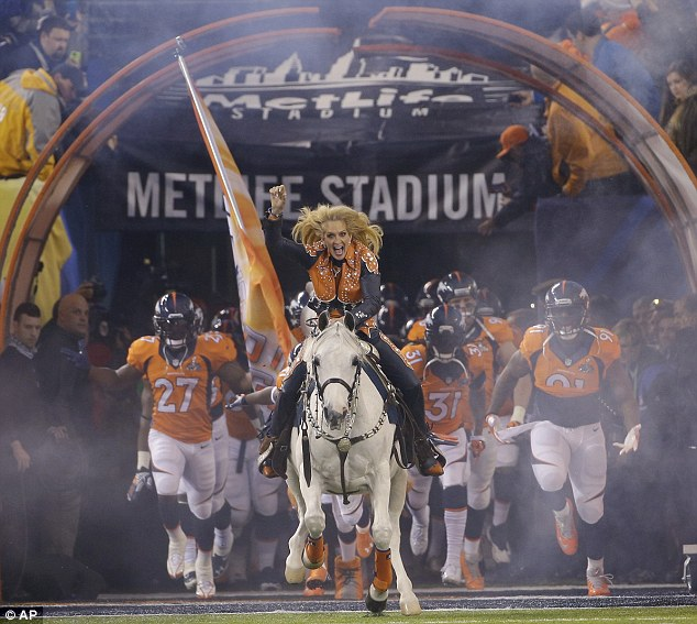 Here they come: Thunder the horse leads the Denver broncos onto MetLife Stadium