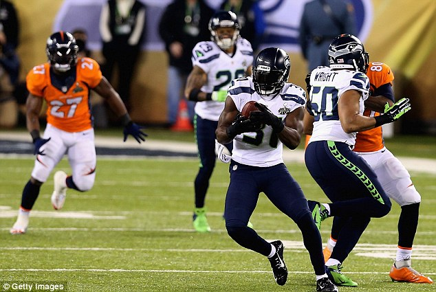 Picked off: Kam Chancellor intercepts Manning's wayward pass