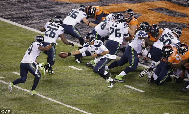 Beast mode: Marshawn Lynch is handed the ball and makes his way into the endzone for a touchdown