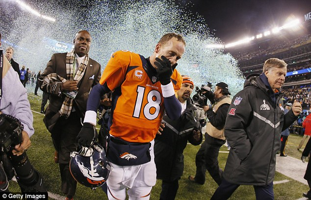 Disappointment: Peyton Manning holds his head in his hand after a shocking defeat at Super Bowl XLVIII