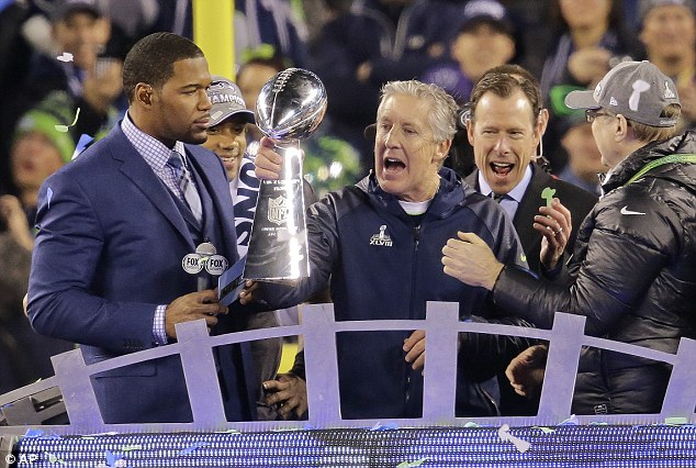 Winners! Seahawks head coach Pete Carroll lifts the Vince Lombardi trophy after a brilliant win