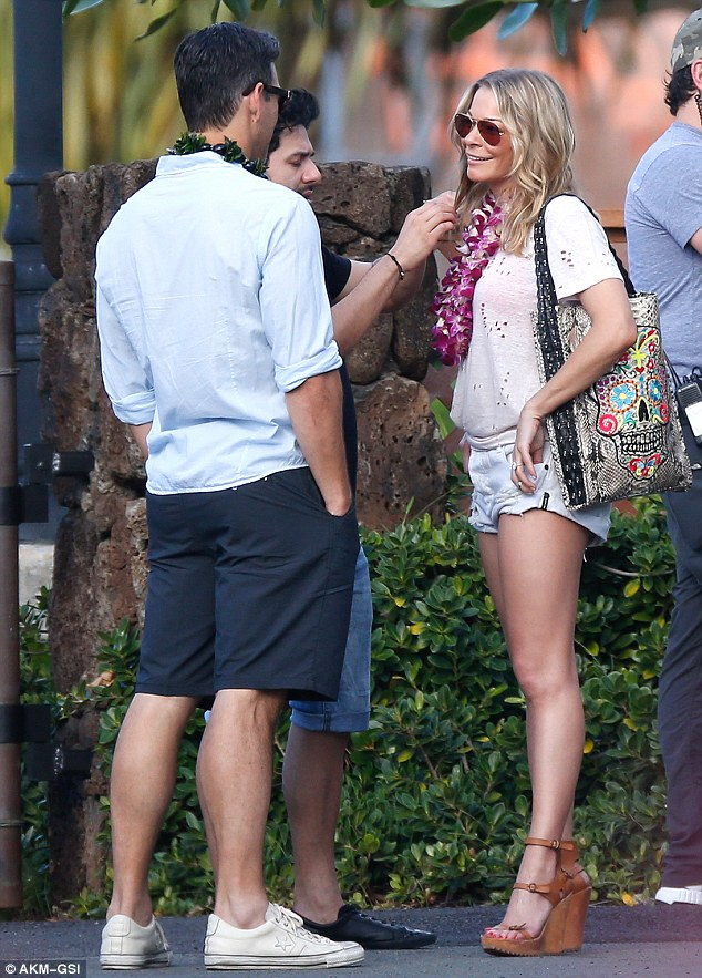 Filming in Hawaii: Singer LeAnn Rimes is wired for sound as she and husband Eddie Cibrian ready to mug for the cameras. Their new reality show debuts soon on VH1