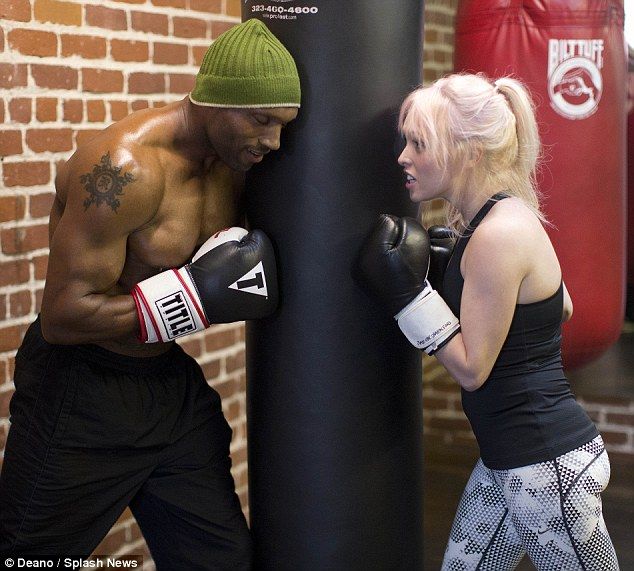 Squaring up: Jorgie and Rhino look like they both worked up a sweat after pummeling a punching bag