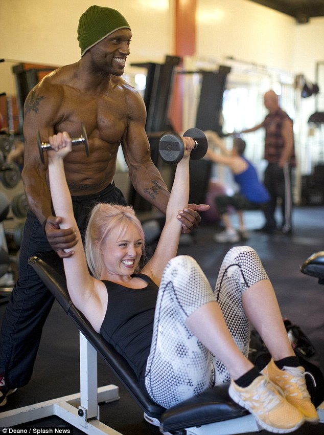 Flex those biceps! Jorgie Porter gets a personal training session from former Gladiator Mark Smith (aka Rhino) in Los Angeles on Monday
